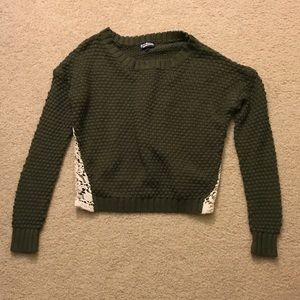 Dark green sweater with lace inset on the sides